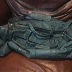 Leather teal duffel bag!